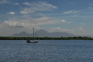 Curareat anchor in front of Volcan san Cristobal