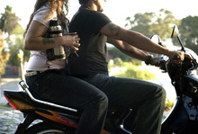 Mate on motorcycle