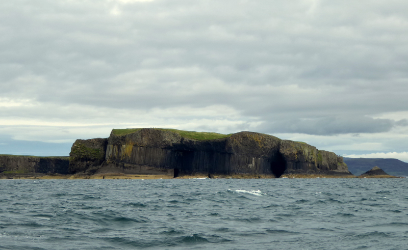 Island of Staffa - Fingals cave on the right