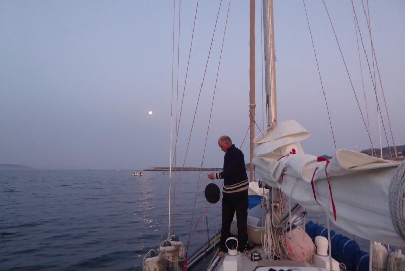 Taking down the anchor ball at dawn