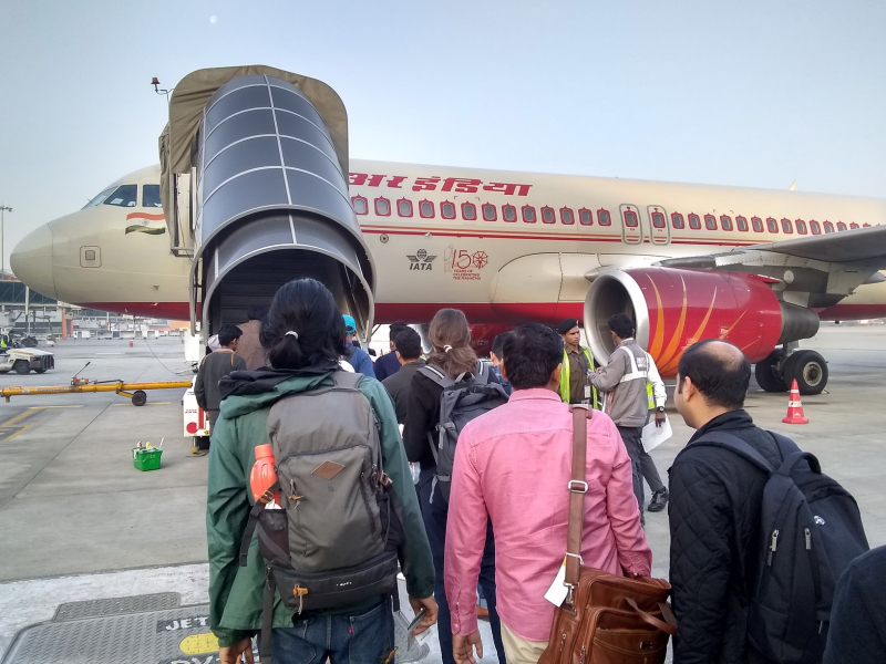 Boarding plane in New Delhi