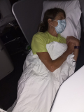 LE sleeping on plane