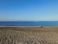 Curare anchored at beach