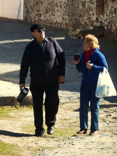 Tourists drinking mate